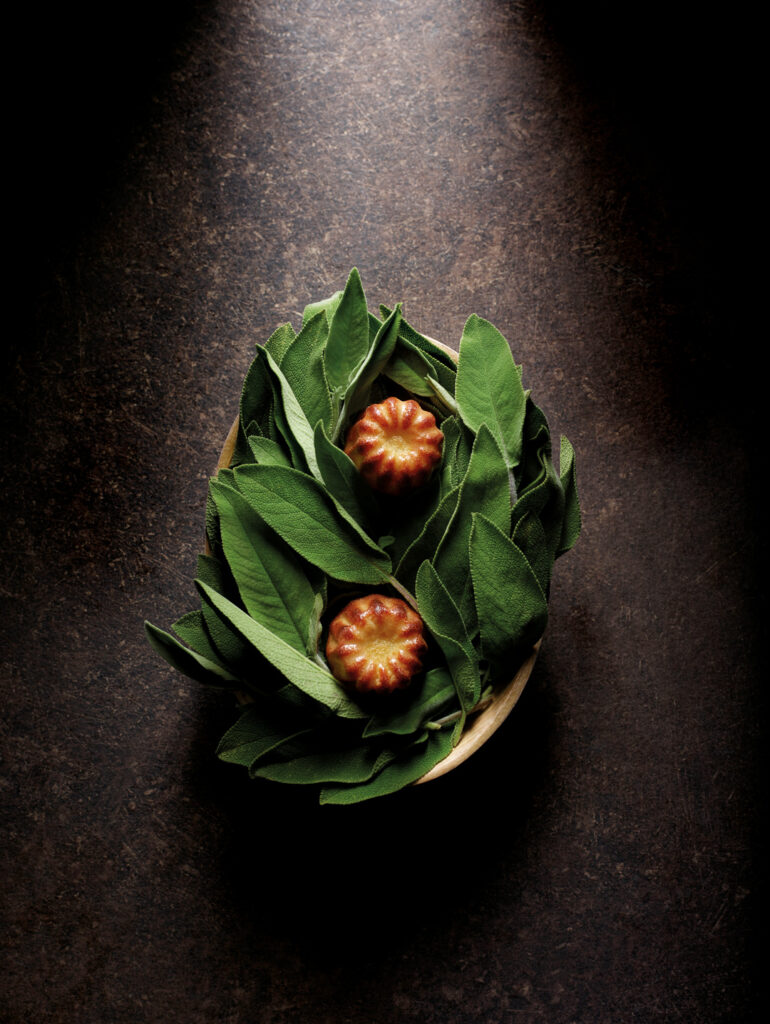 Sage and comté cheese caneles served at Mirazur pop-up at Mandala Club in Singapore