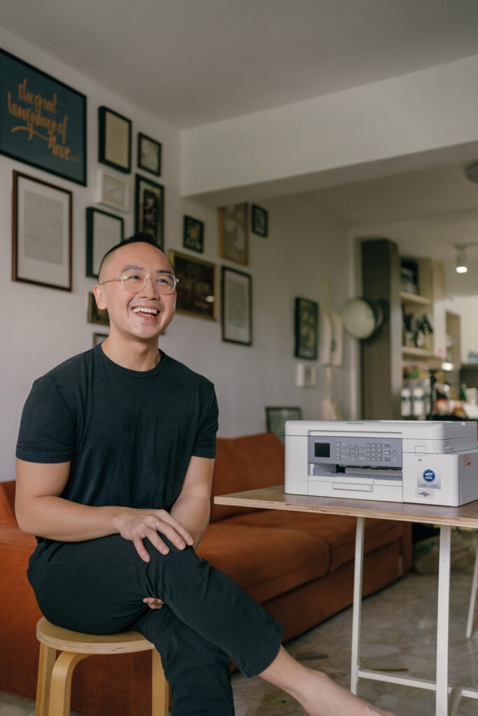 Calligrapher and founder of type studio Craft Varies Clarence Valerius Wee in his home office equipped with the Brother International wireless colour printer scanner