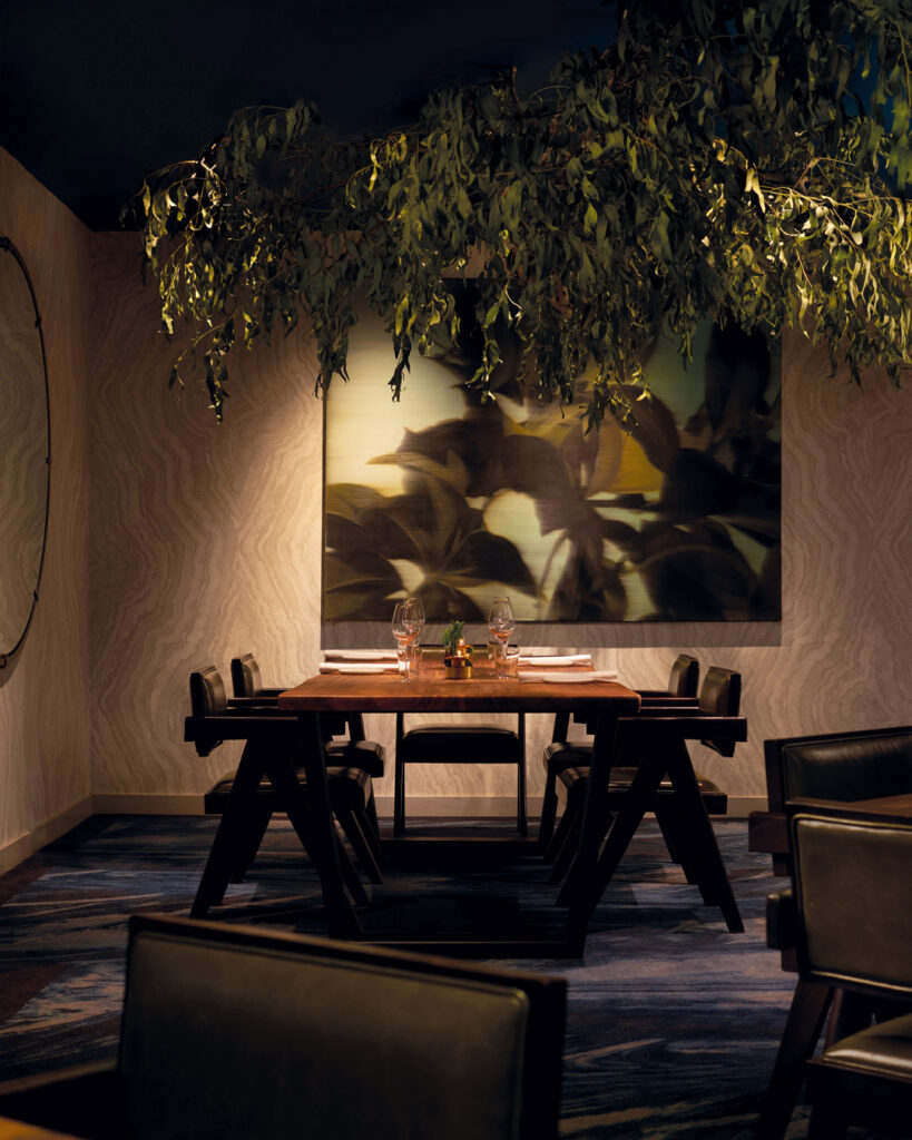 Interior of the Mirazur pop-up at Mandala Club in Singapore, decorated in a botanical theme in accordance with the menu theme launched, Leaves, and with paintings curated by The Artling